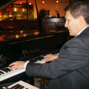 German E. VEGA, Piano player - Calgary Ab